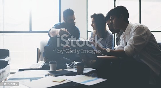 912617272 istock photo Business meeting concept.Coworkers team working new startup project at lightful office.Analyze business documents, laptop on table.Blurred background.Horizontal 931829866