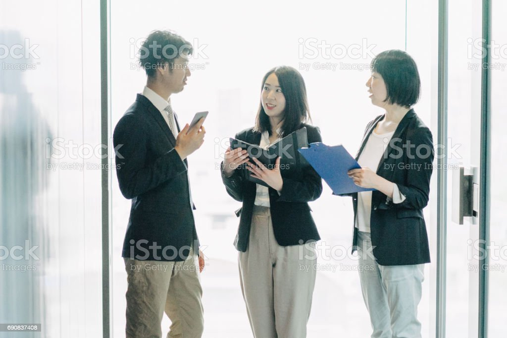 Business meeting, co-workers discussing a new project stock photo