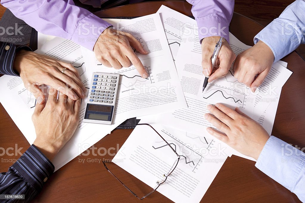Business meeting going over investments royalty-free stock photo