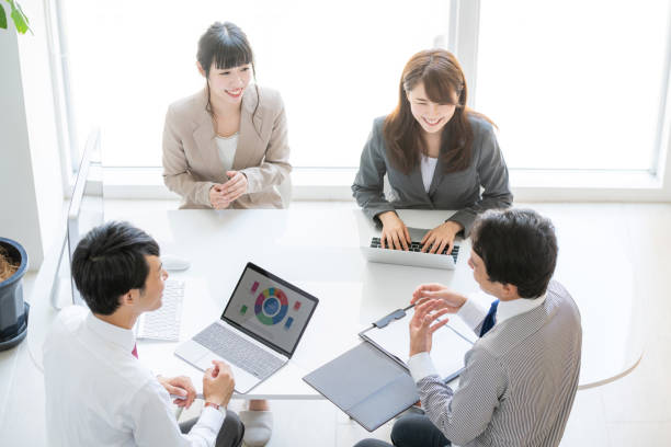 Business meeting. High angle view. Business meeting. High angle view. korean ethnicity stock pictures, royalty-free photos & images