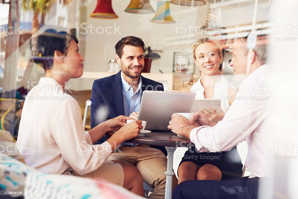 Business meeting in a cafe stock photo