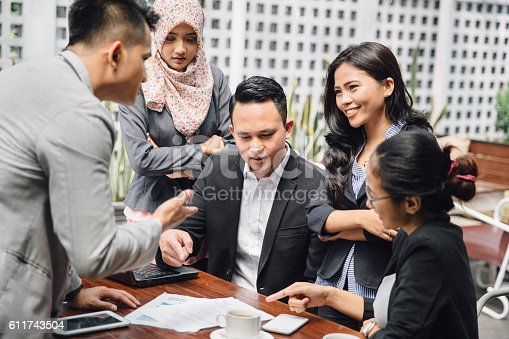 istock Business meeting in a cafe 611743504