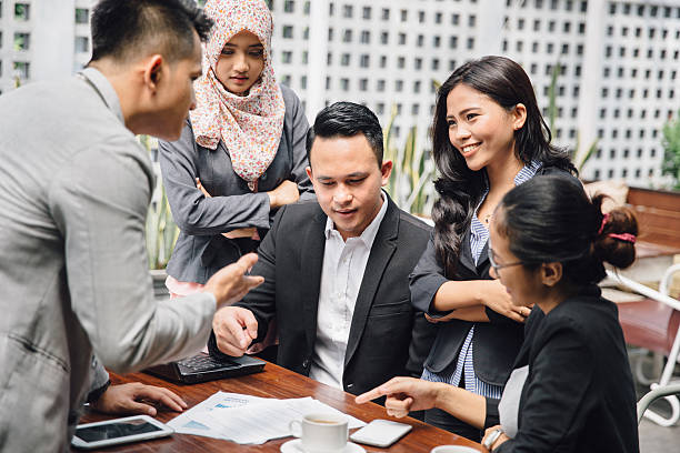 Business meeting in a cafe portrait of Business people in cafe discussing work at cafe indonesian ethnicity stock pictures, royalty-free photos & images