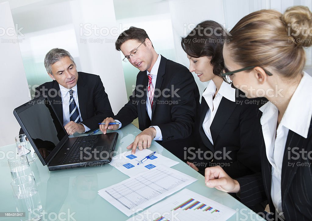 Business meeting in a conference room with a lucite table royalty-free stock photo