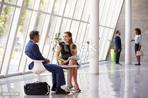 504879112istockphoto Business Meeting In Busy Office Foyer Area 504879236
