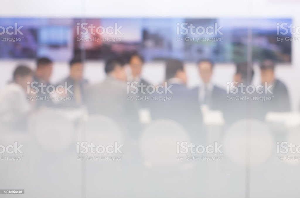 Business Meeting in Conference Room with Group of People. De-focused Blurred stock photo