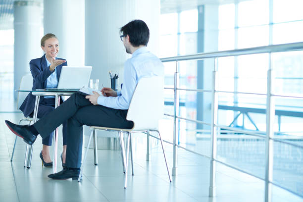 business meeting in office building - bankers stock photos and pictures