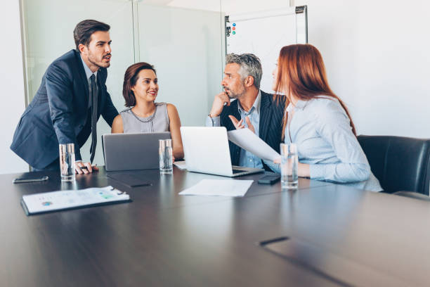 business meeting in the conference room - four people stock photos and pictures