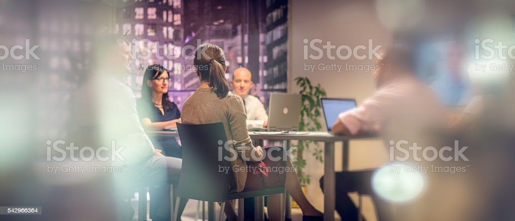 Business meeting late at night stock photo