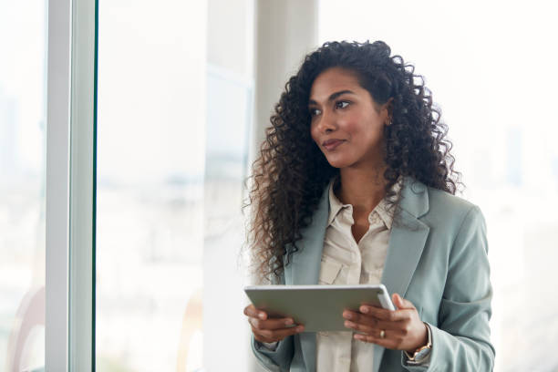 Business meeting. Mixed race businesswoman smiling in foreground stock photo