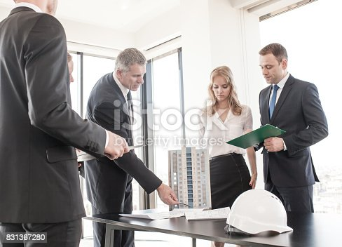 istock Business meeting of architects and investors 831367280