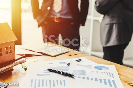 istock Business meeting of real estate broker, Business meeting working with new startup project. Idea presentation analyze plan. 1044942830