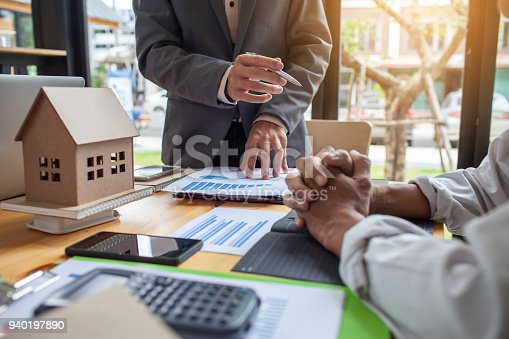 istock Business meeting of real estate broker, Business meeting working with new startup project. Idea presentation analyze plan. 940197890