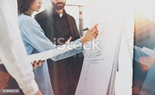 533699494istockphoto Business meeting office.Photo woman writing statistics info chart board 528583232