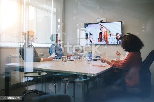Group of young business people discussing with colleagues  on video conference on meeting.