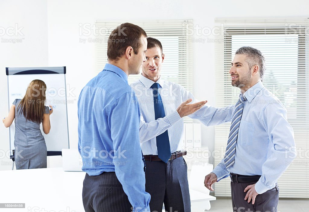 Business meeting Three happy businessmen discussing in a boardroom. 30-34 Years Stock Photo
