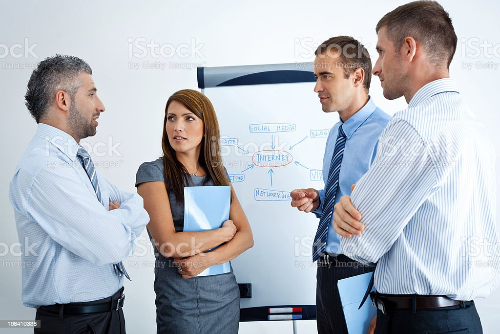 Business meeting Four business people discussing strategy of their company. 30-34 Years Stock Photo