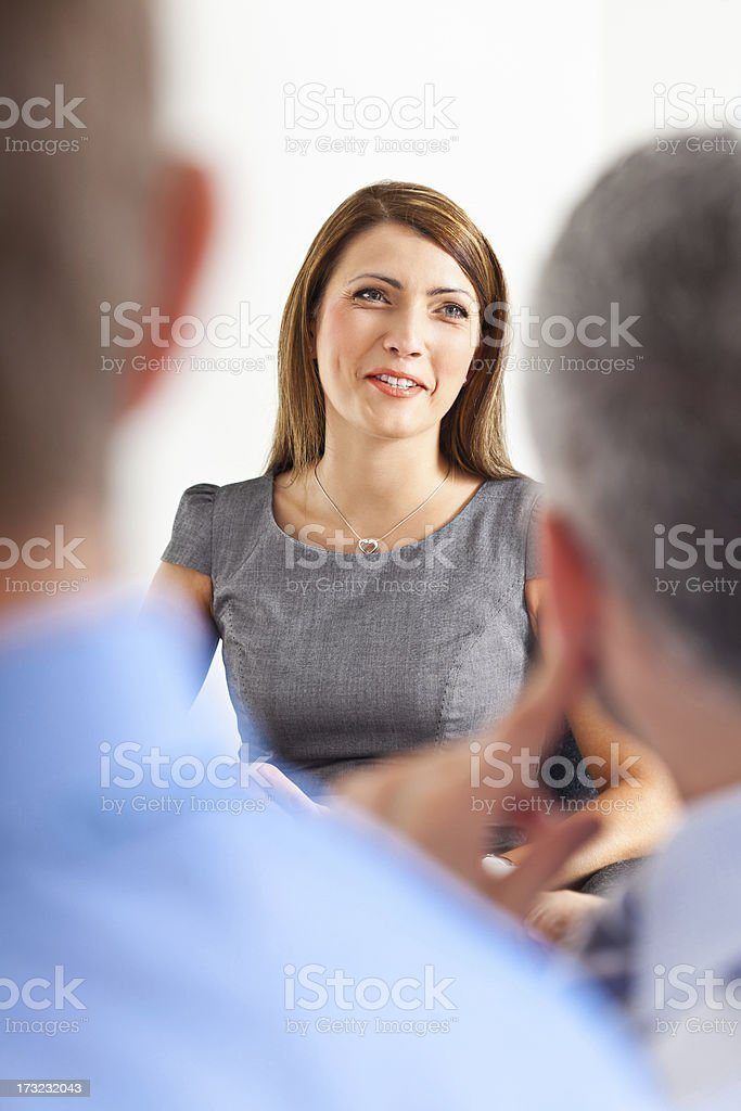 Business meeting Focus on the happy businesswoman giving presentation to his business colleague. Achievement Stock Photo