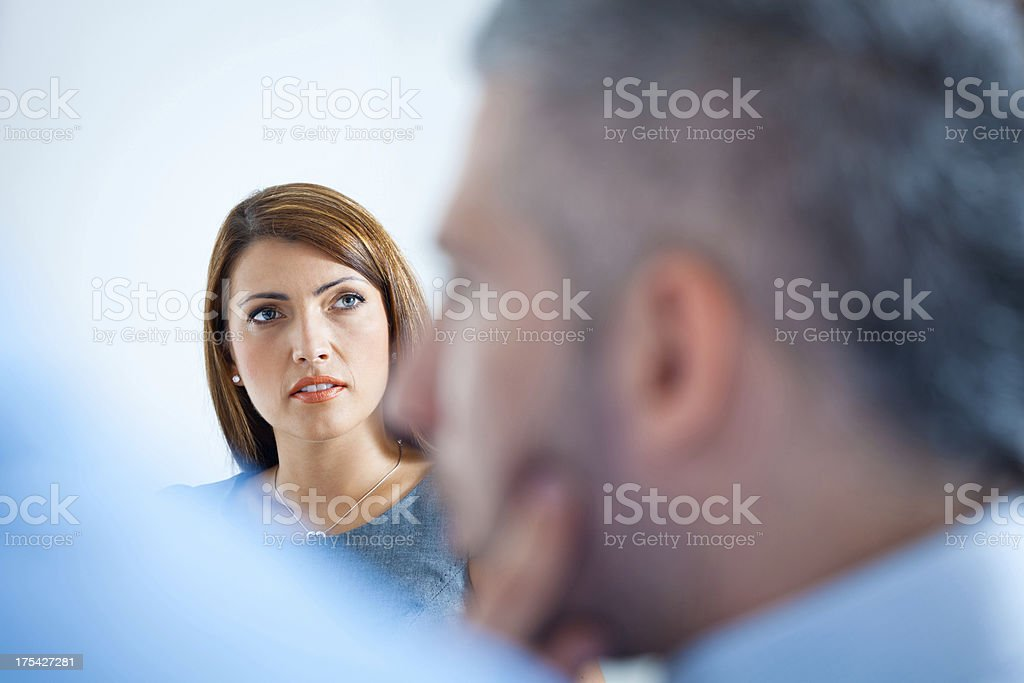 Business meeting Focus on the businesswoman listening to her business colleagues during business meeting. Adult Stock Photo