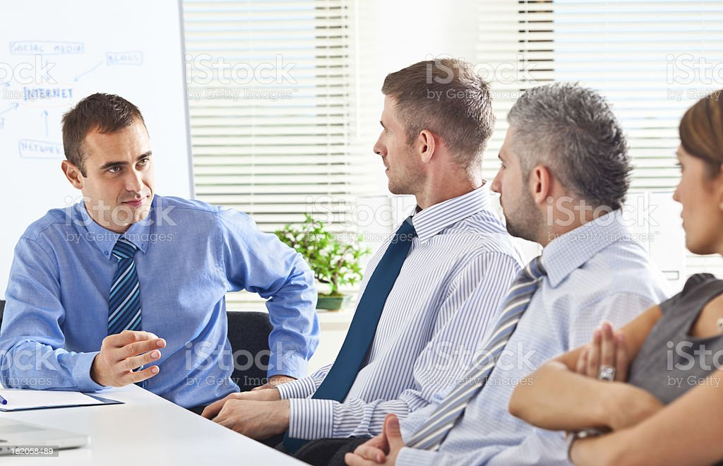 Business meeting Business team discussing new strategy of their company in a boardroom. 30-34 Years Stock Photo