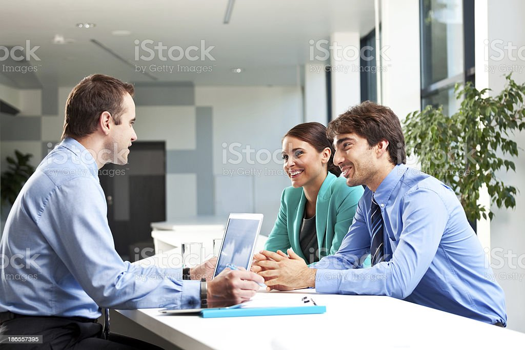 Business meeting Businesspeople discussing new strategy of their company. Adult Stock Photo