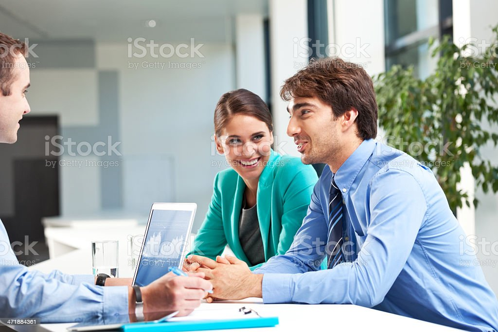 Business meeting Cheerful businesspeople discussing new strategy of their company. Adult Stock Photo