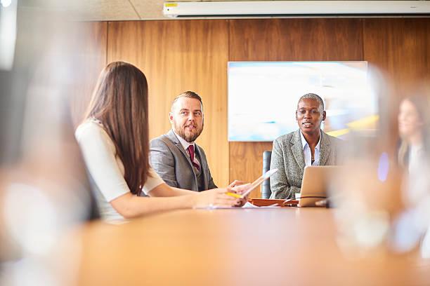 business meeting - four lawyers stockfoto's en -beelden