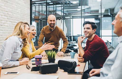 Cheerful business people laughing in office