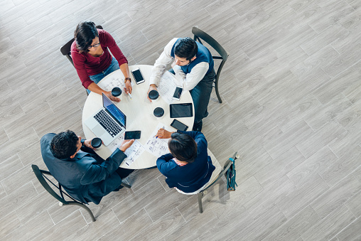 Overhead view of a business meeting in office space