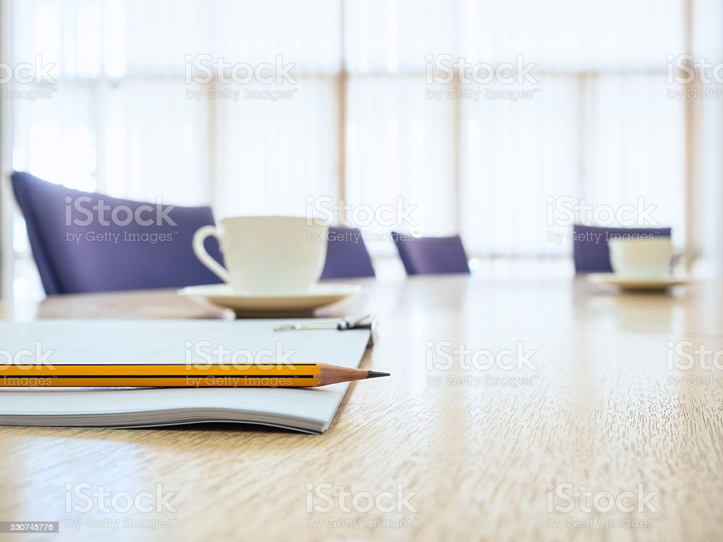 Business meeting Table with Seats Coffee and book Board room stock photo