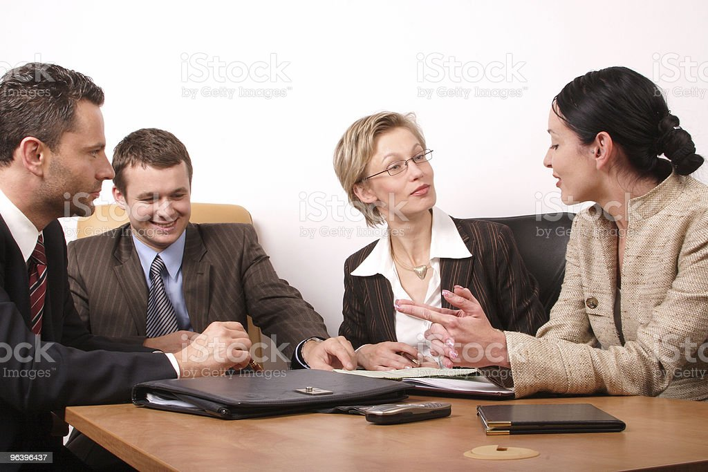 Business meeting  - two women, 2 men - Royalty-free Adult Stock Photo