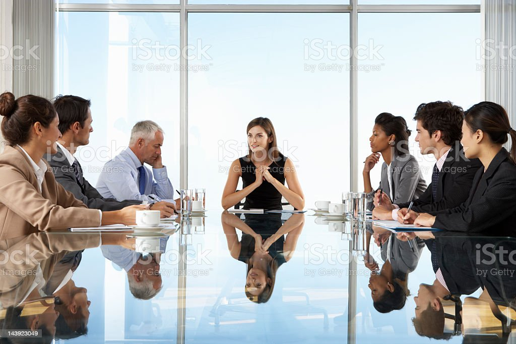 Business meeting with the table reflecting the sky  stock photo