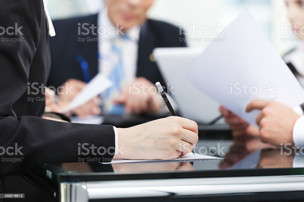 Business - meeting in an office, lawyers or attorneys discussing a...
