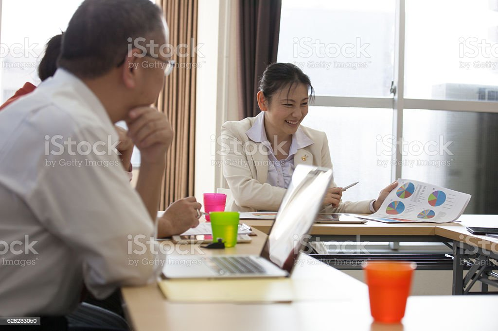 Business meeting with young female manager stock photo
