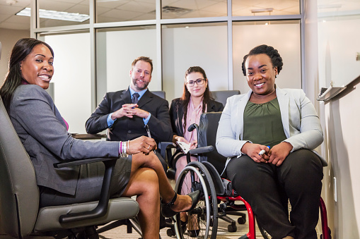 660681964 istock photo Business meeting, woman in wheelchair at whiteboard 1171432156