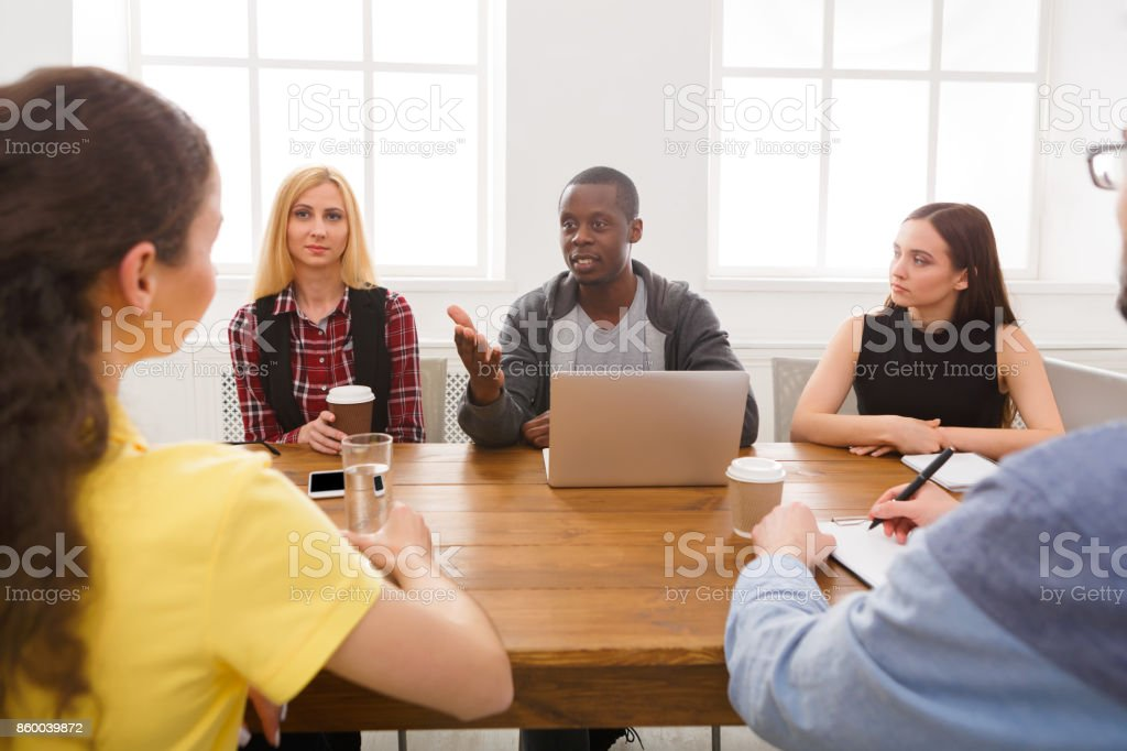 Business meeting. Young team in modern office stock photo