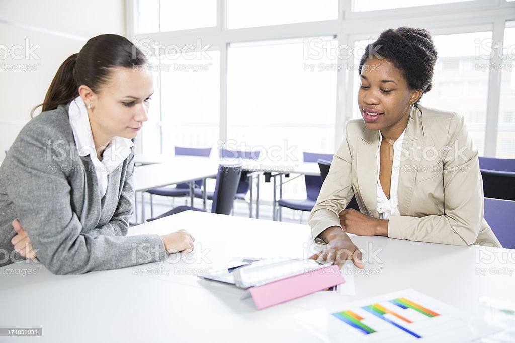Business meeting..two women checking data on digital tablet royalty-free stock photo