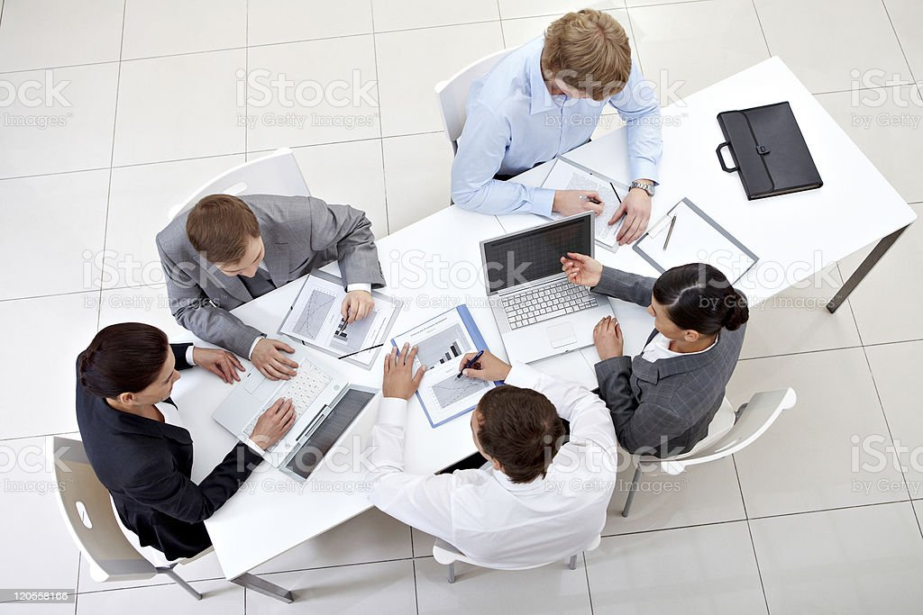 Business men and women in an important meeting royalty-free stock photo