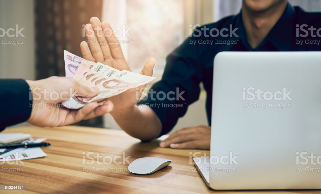 Business Men are refusing to get paid with benefits that make it work faster than others.The concept of not accepting money for corruption stock photo