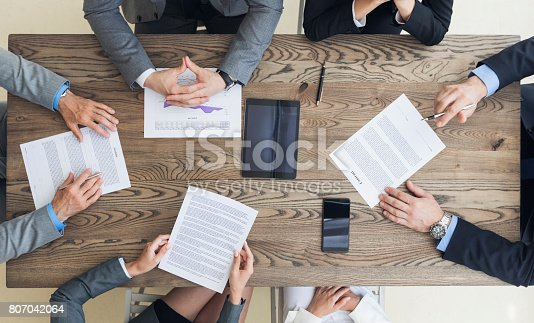istock Business men discussing contract terms 807042064