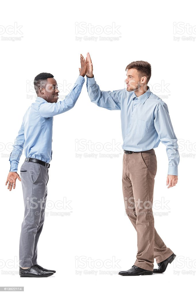 business men giving each other a high five stock photo