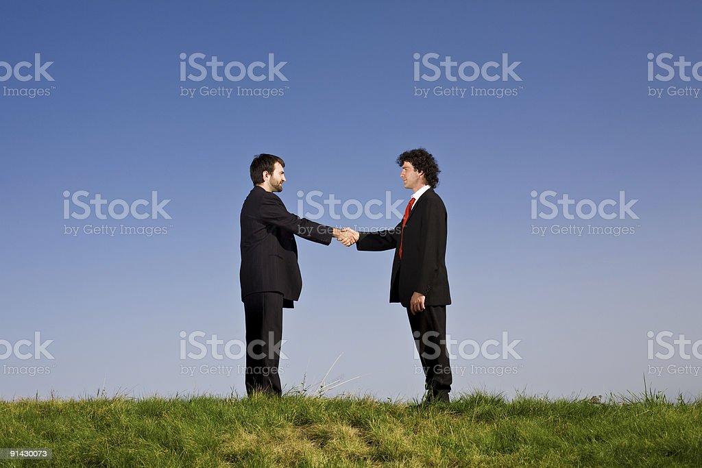 business men handshake outdoor royalty-free stock photo