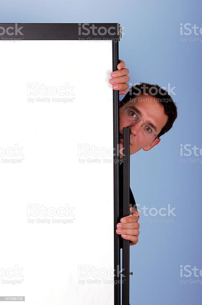 Business men hide behind blackboard royalty-free stock photo