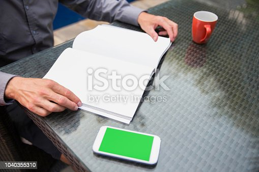 621728016istockphoto Business men keeping informed with news 1040355310