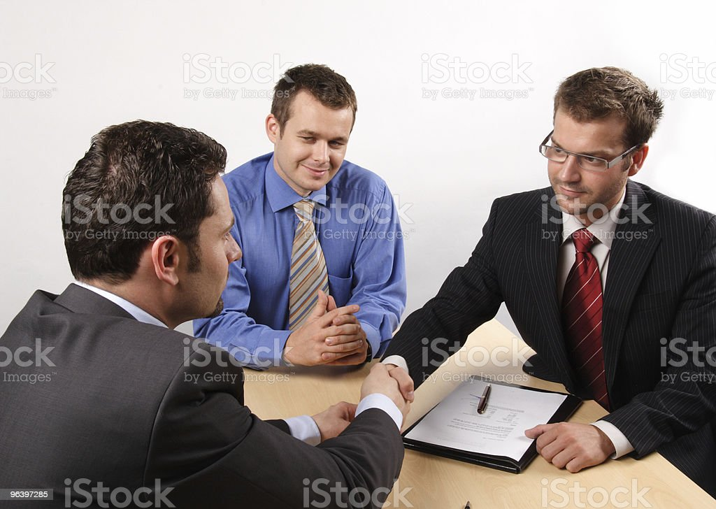 business men negotiating and signing a contract. handskake. stock photo