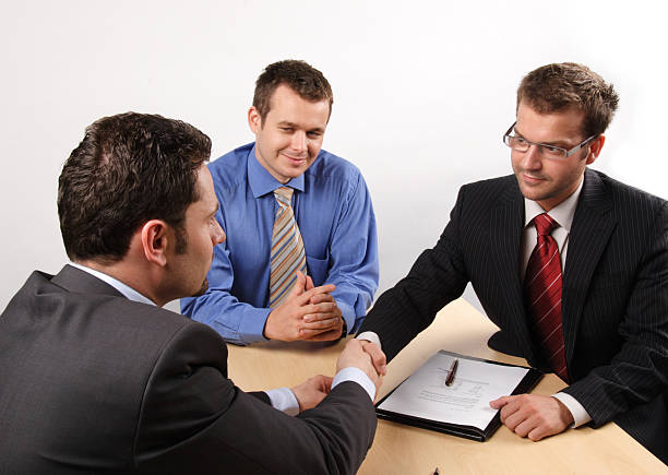 business men negotiating and signing a contract. handskake.  salé morocco stock pictures, royalty-free photos & images