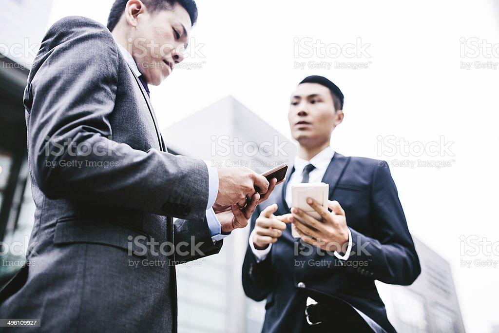 Business Men on Smartphones royalty-free stock photo