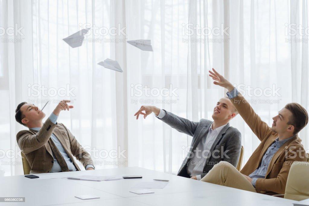business men paper plane meeting break fun stock photo