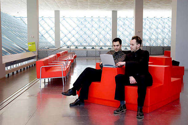 Business Men - Red Chair 1 stock photo