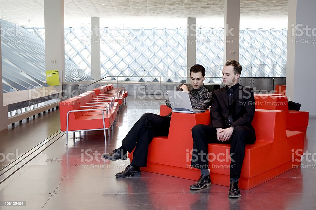 Business Men - Red Chair 2 royalty-free stock photo